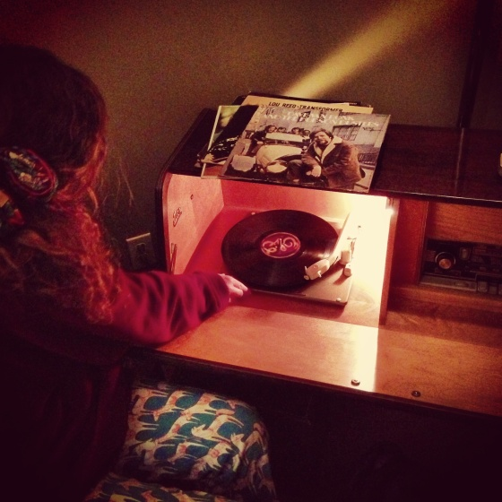 Carissa spinning tunes on the old record player
