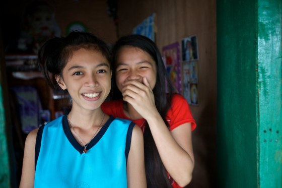 These sweet girls helped bag up food for the community due to the coming Typhoon the day before. It was hard work to get them to stop laughing long enough for a photo. Carla is in high school and Carmelita is a 1st year college student with a major in accounting. There education is due to support from Bajao Bridge.
