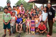 House parents Chamra and his wife Phalla with their New Hope for Orphans family, Poipet, Cambodia — at Poipet, Cambodia-Thai Border.
