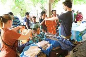 Distributing clothing to children in Villa Comaltitlan, Mexico from pastor Damián's house.