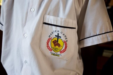 These beautiful uniforms are starting to be made at the tailor shop that the Masters foundation has opened that both teaches young adults how to be expert tailors and reduces the cost of uniforms to the school – smart business.