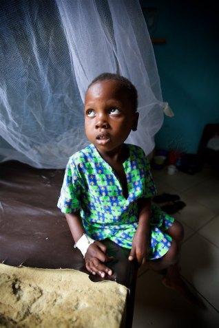 Five year old Kasujja that just wanted his hand held while being treated for anemia and Malaria at the clinic