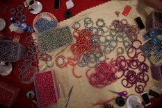 Photographing the necklaces made by the ladies in the Adera program
